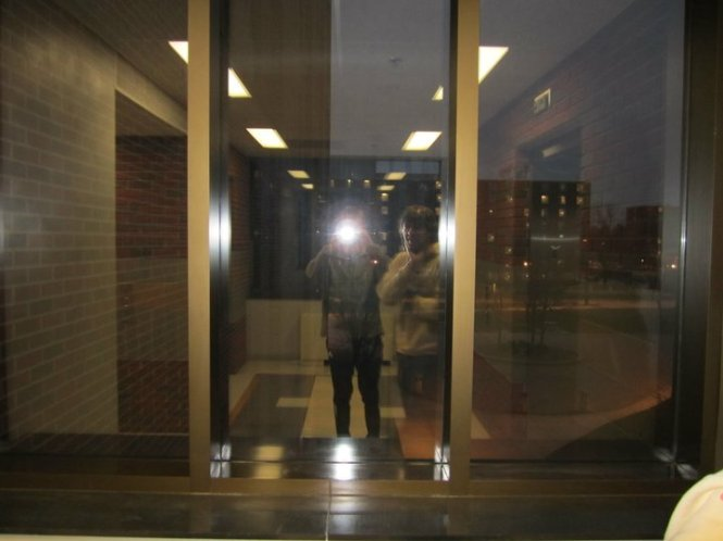 A Friend Snaps a Photo of Our Reflections in the Window as We Wait for an Elevator on the Campus of Purdue University, 12/1/2010